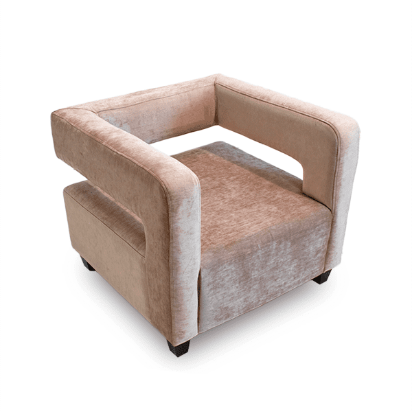 pink velvet lounge chair with cut out back